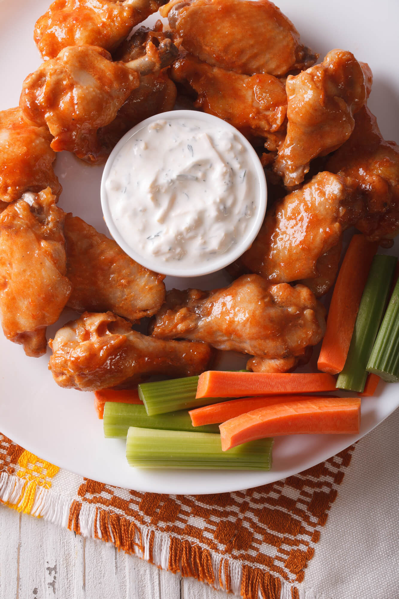 Crispy baked buffalo wings with ranch dressing, celery, and carrots.