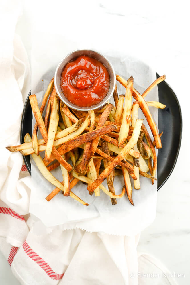 Turnip fries on a plate with ketchup.