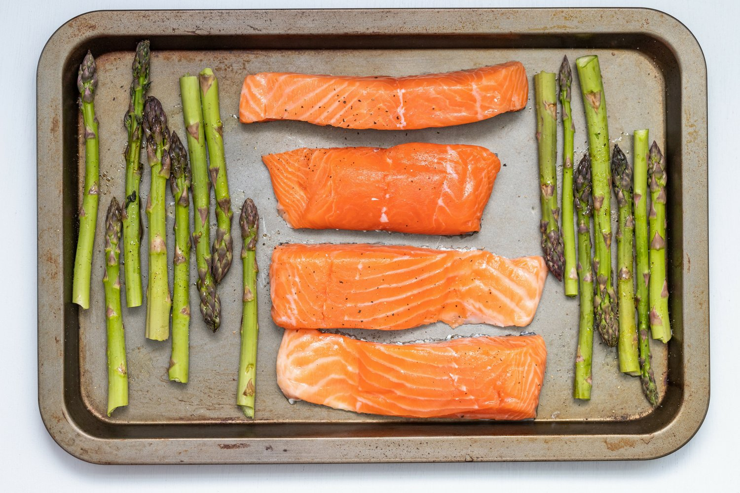 Salmon recipe with asparagus on a sheet pan.