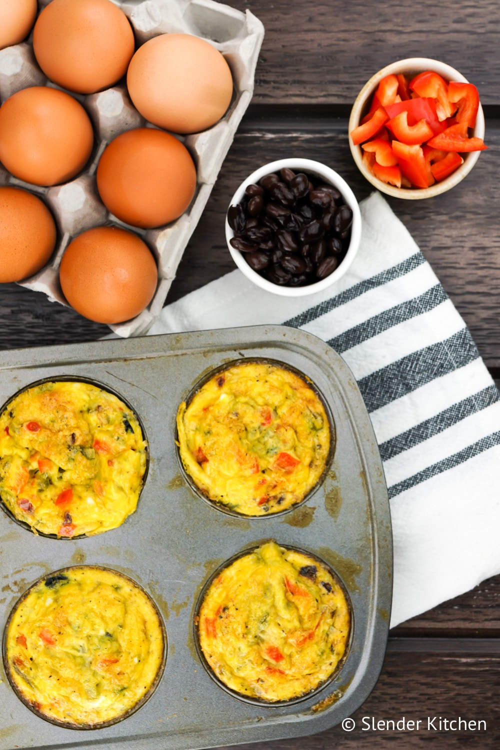 Healthy Egg Muffins with black beans, red peppers, onion, and jalapeno.
