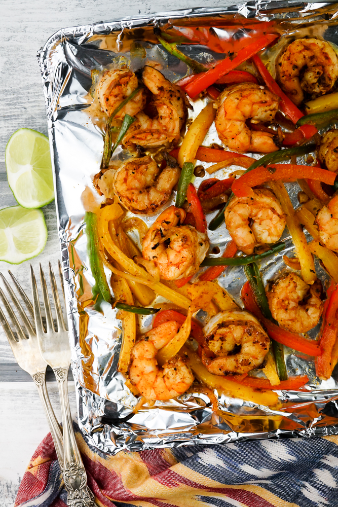 One Pan Shrimp Fajitas make a delicious 15 minute dinner and are packed with shrimp, peppers, onions, and a homemade fajita seasoning.