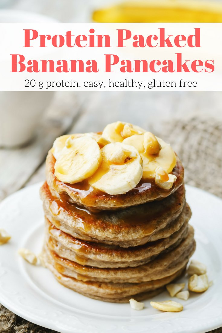 Banana Protein pancakes with cashews and bananas on a plate with honey.