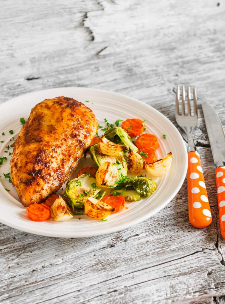 Baked Cajun Garlic Chicken with carrots and brussels sprouts.