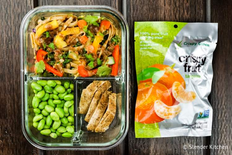 Bistor box with dried tangerines, Asian pasta salad, and edamame.