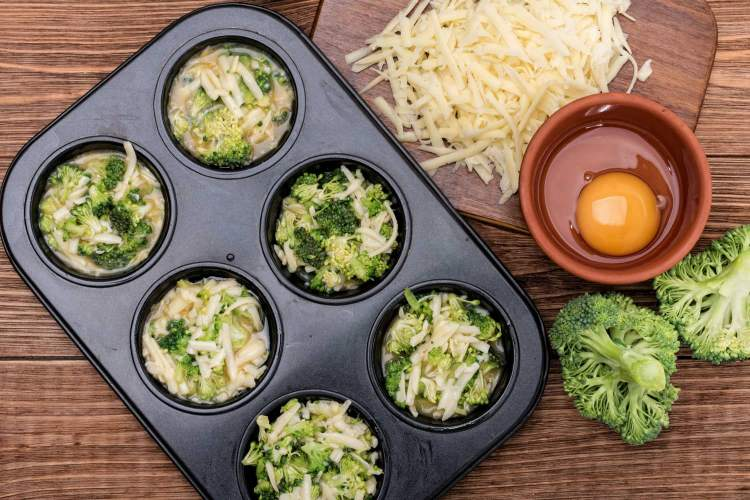 Broccoli Cheddar Egg Muffins before going into the oven to be baked.