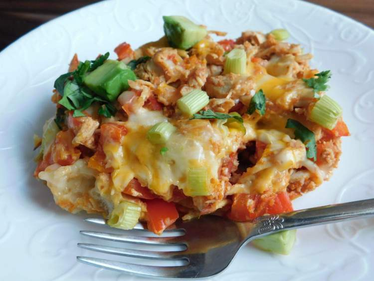 Weight Watchers Chicken Enchilada Bubble Up on a plate with a fork.