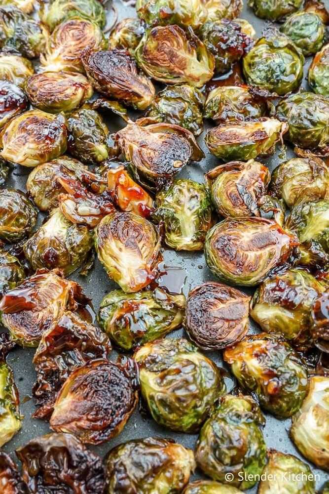 Asian Brussels sprouts recipe on a sheet pan with browned edges.