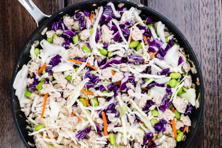 Egg Roll Bowls in the skillet with cabbage, carrots, and onions.