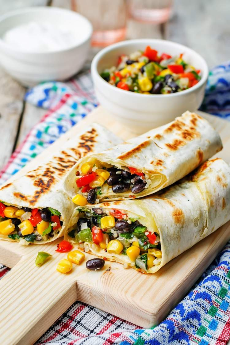 Homemade Frozen Burrito packed with quinoa, black beans, and corn.