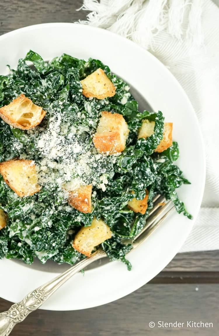 Kale Caesar Salad with parmesan cheese and croutons.