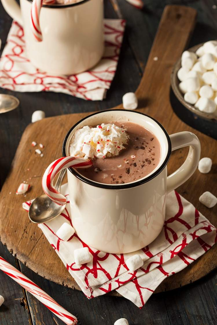 Healthy Peppermint Mocha with a candy cane and whipped cream.
