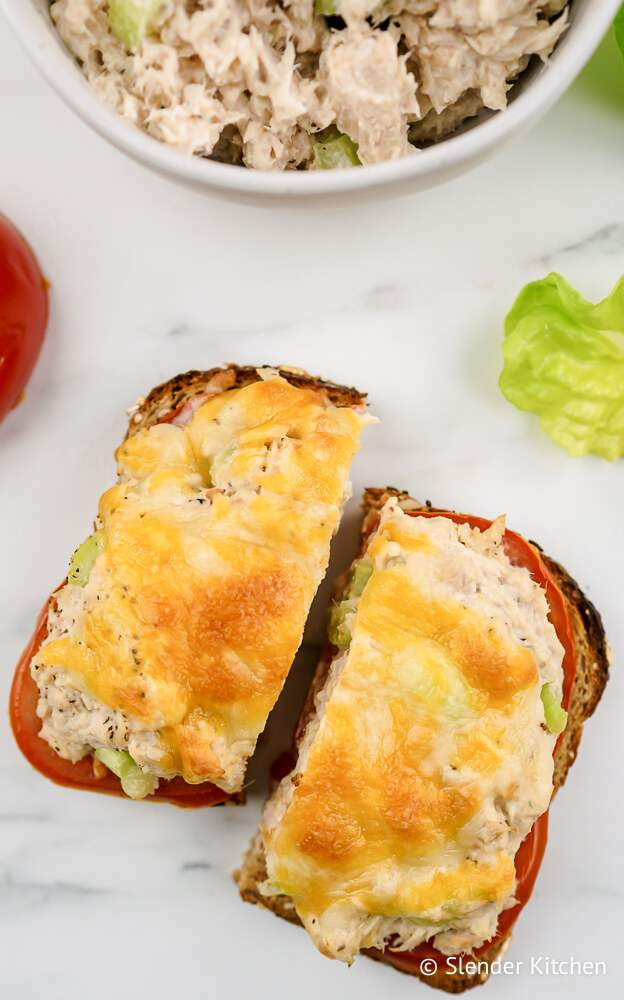 Tuna melts on wheat bread with tomatoes and melted cheese.