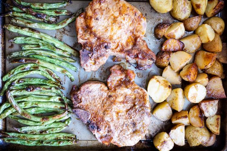 Sheet Pan Pork Chops, Potatoes, and Green Beans caramelized and ready to eat.