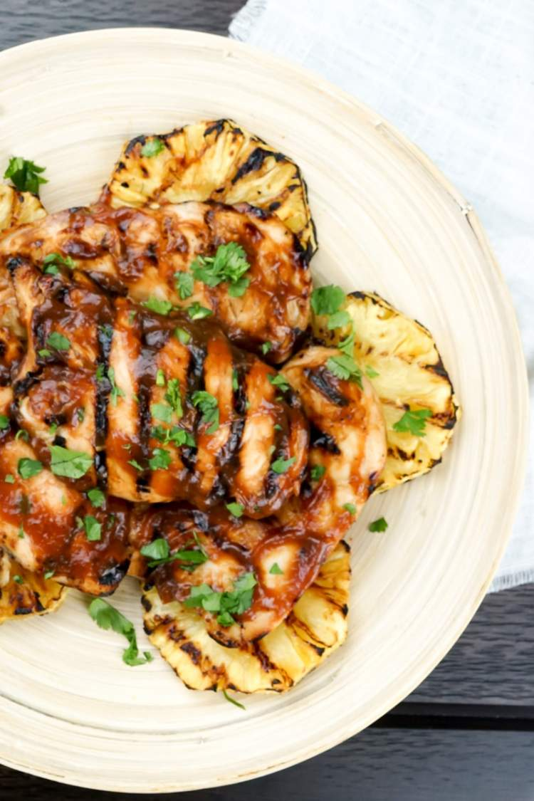 Grilled Pineapple Barbecue Chicken with parsley sprinkled on top.