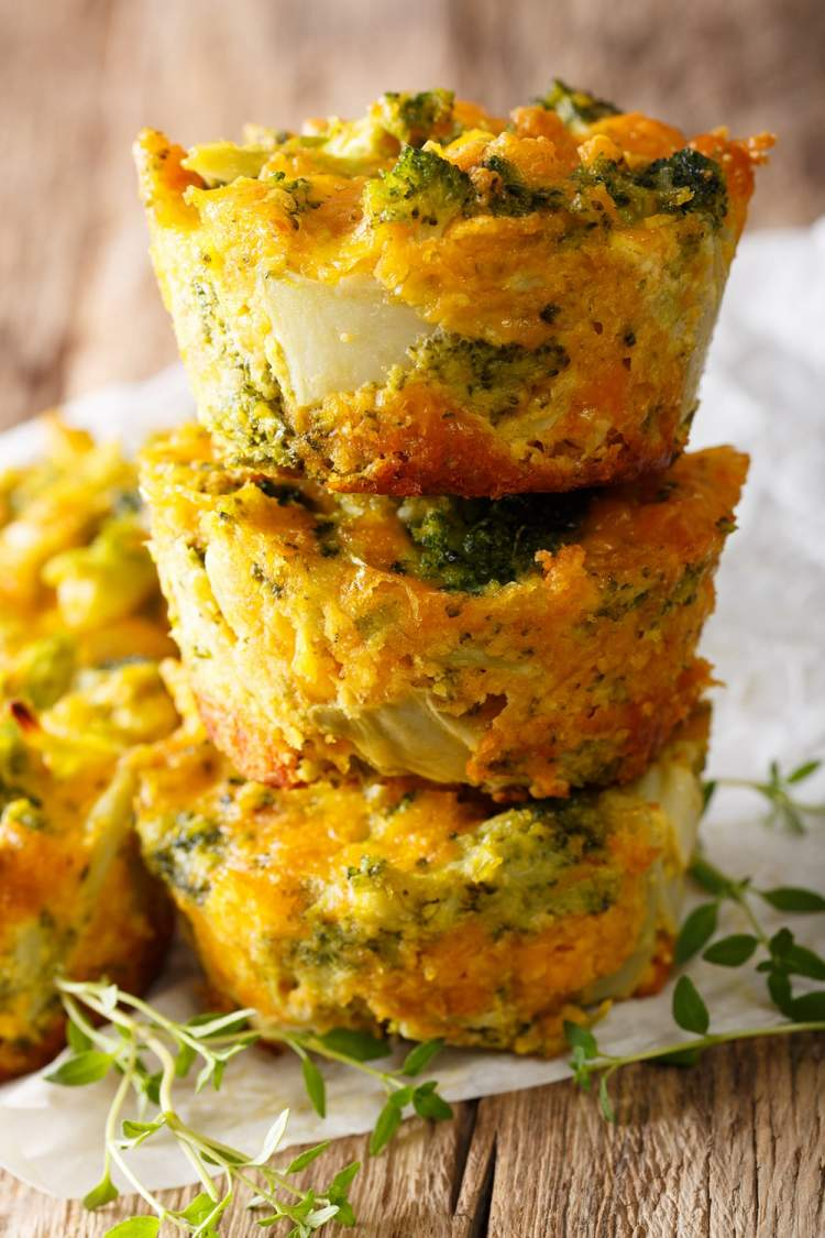 Weight Watchers quiche muffins stacked on top of each other with broccoli and turkey.