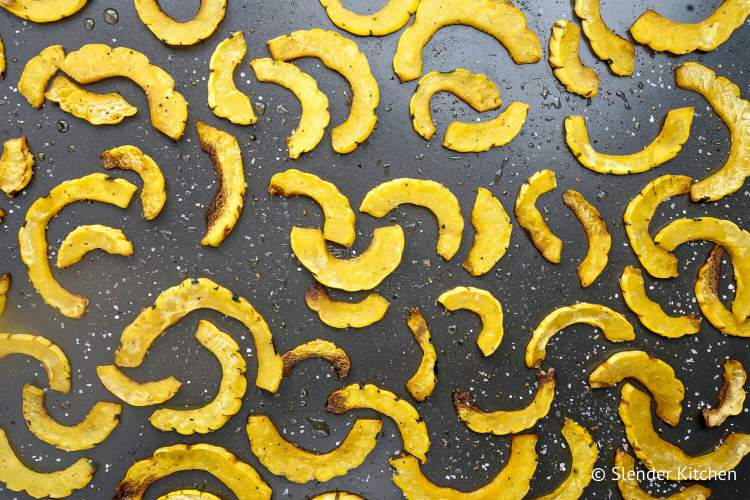 Roasted delicatat squash on a sheet pan.