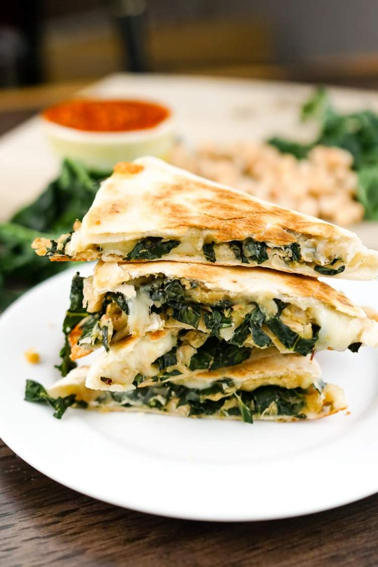 Rosemary White Bean and Kale Quesadilla cut into fourths and stacked.