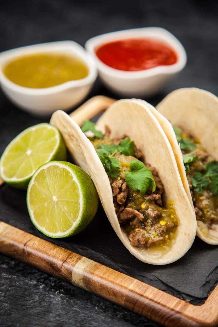 Salsa verde ground turkey tacos in corn tortillas with jalapenos, cilantro, and limes.