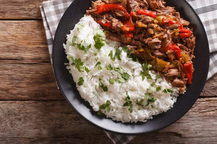 Slow Cooker Beef Machaca on a plate with rice.