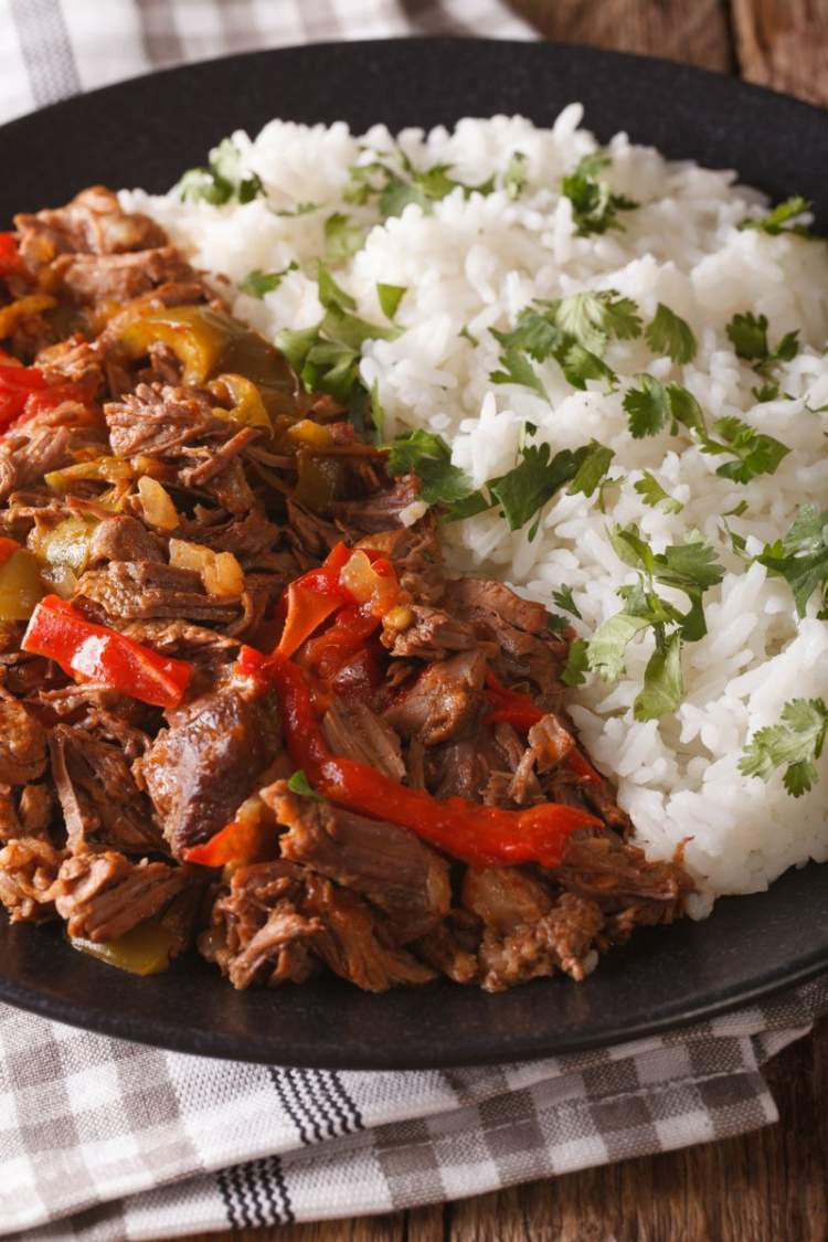 Slow Cooker Beef Machaca with tomatoes, rice, and cilantro.