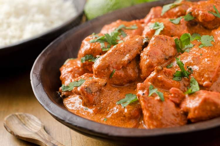 Weight Watchers Slow Cooker Butter Chicken in a bowl with cilantro.