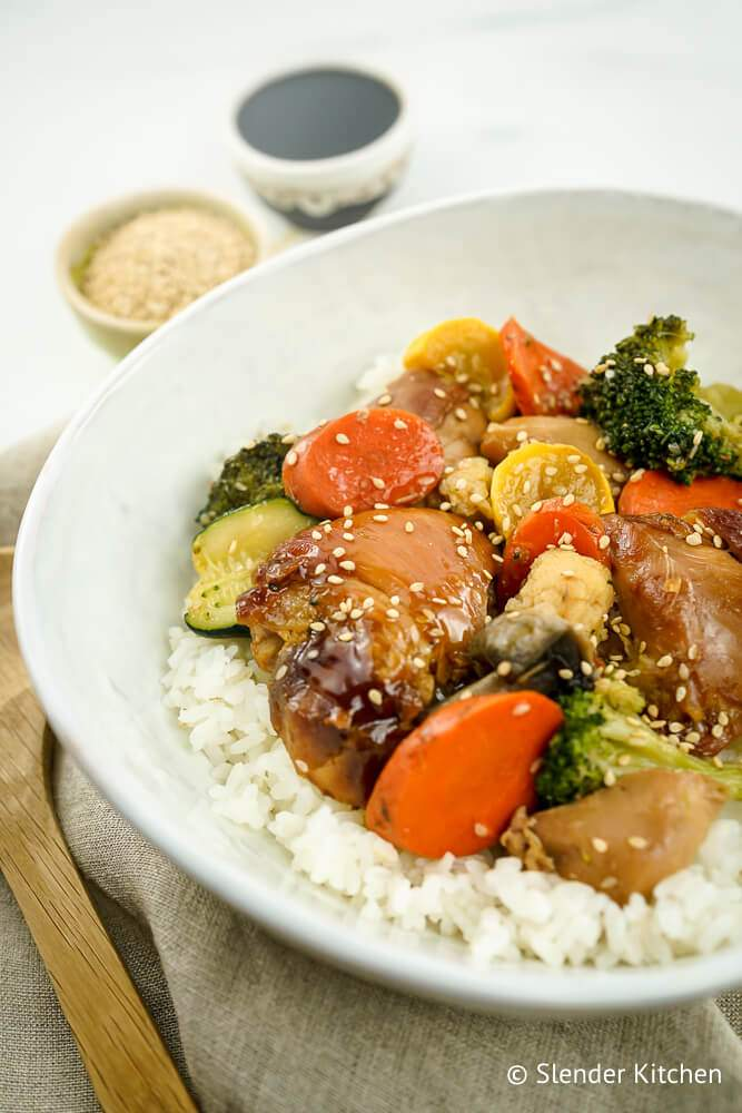 Slow Cooker Teriyaki Chicken on a plate with vegetables and rice.