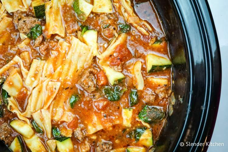 Healthy Slow Cooker Lasagna Soup with noodles, zucchini, and ground beef in a slow cooker.