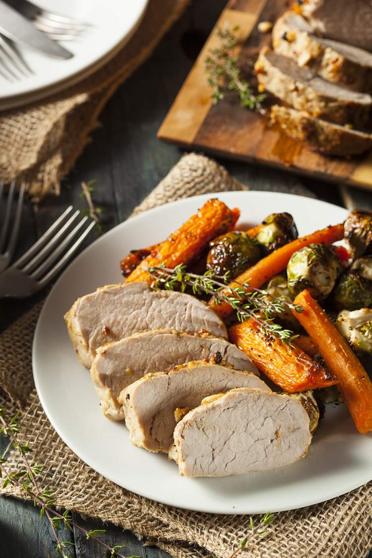 Slow Cooker Maple Pork Tenderloin with carrots and brussels sprouts.