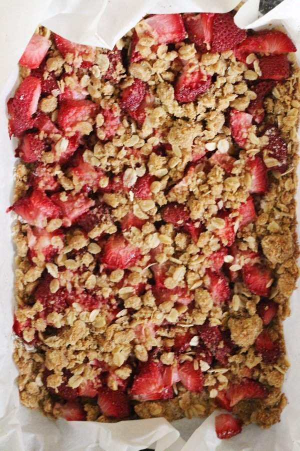Healthy Strawberry Oatmeal Bars ready to be cut and eaten.