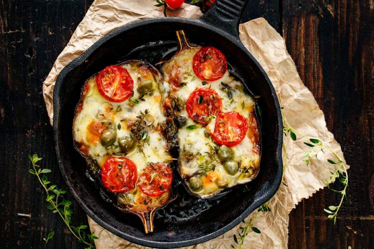Stuffed eggplant with melted cheese and tomatoes.