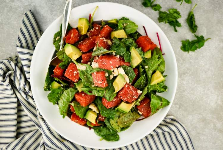Watermelon and Avocado Salad with Honey Lime Vinaigrette with feta and greens.