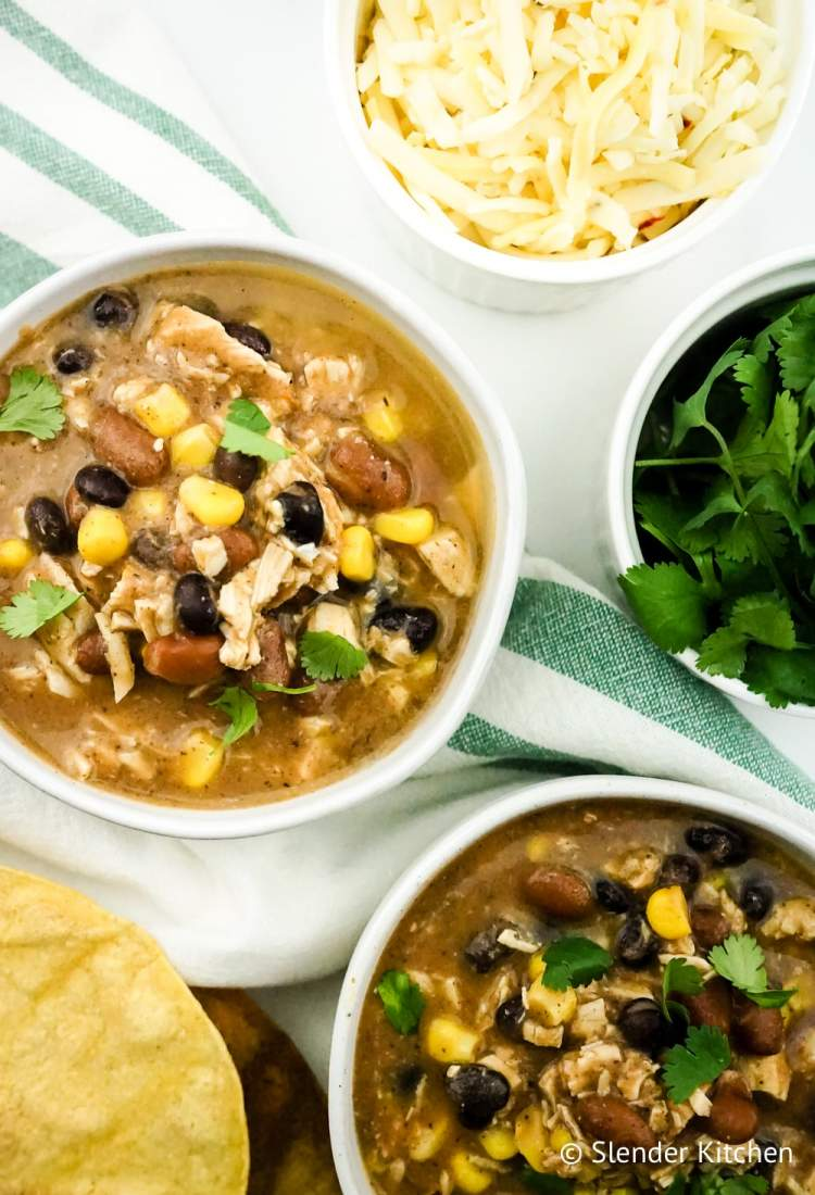 Weight Watchers Taco soup in a bowl with beans, chicken, and cheese.