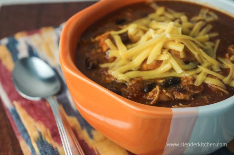 Slow Cooker Chicken Enchilada Soup in a crockpot.