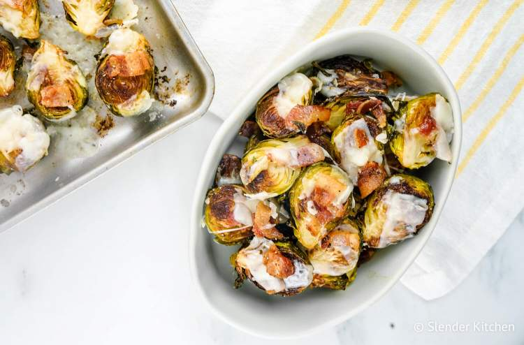 Garlic Bacon Brussels sprouts with Parmesan cheese on a sheet pan.