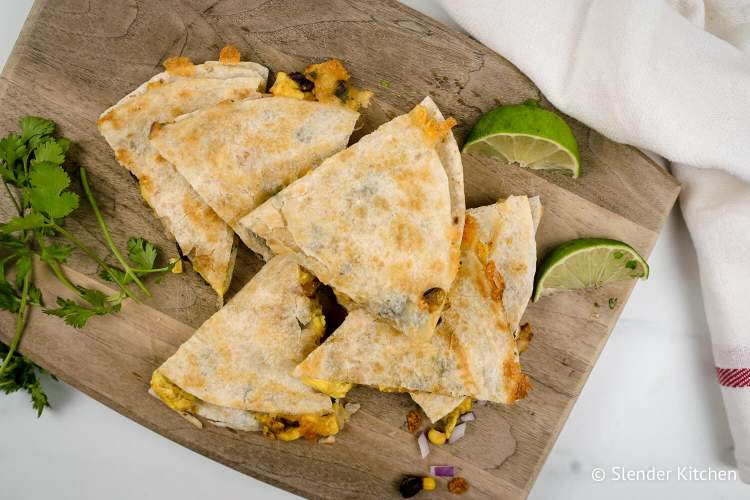 Frozen Breakfast Quesadillas with scrambled eggs, black beans, salsa, and veggies in flour tortillas.