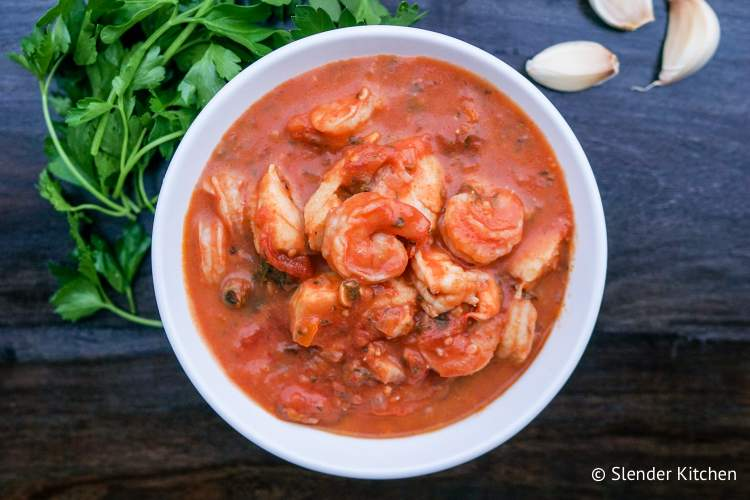 Shrimp and fish stew in tomato stew with basil and parsley.
