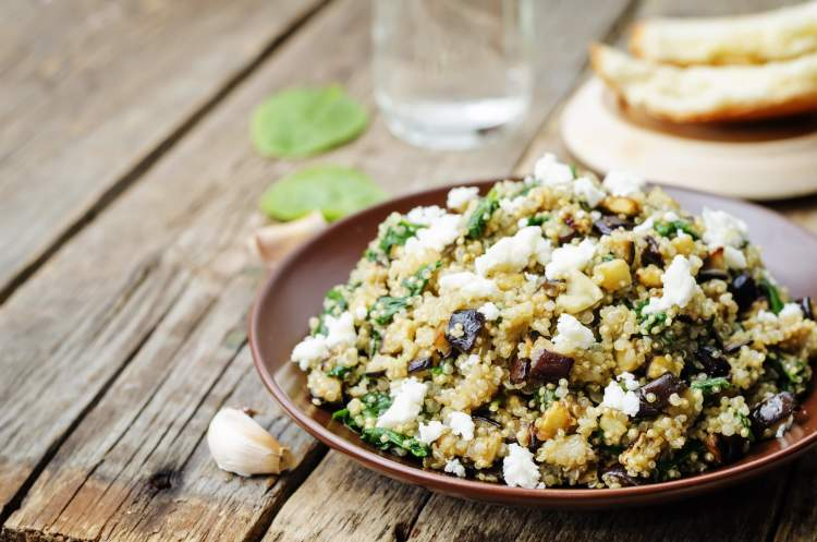 Roasted eggplant with quinoa and feta cheese in a salad.