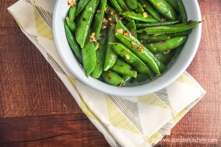 A simple low carb side dish with sugar snap peas, sesame seeds, and red pepper flakes.