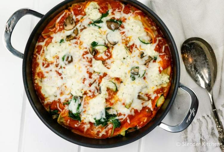 Skillet Vegetable Lasagna on a wooden table in a large pan.