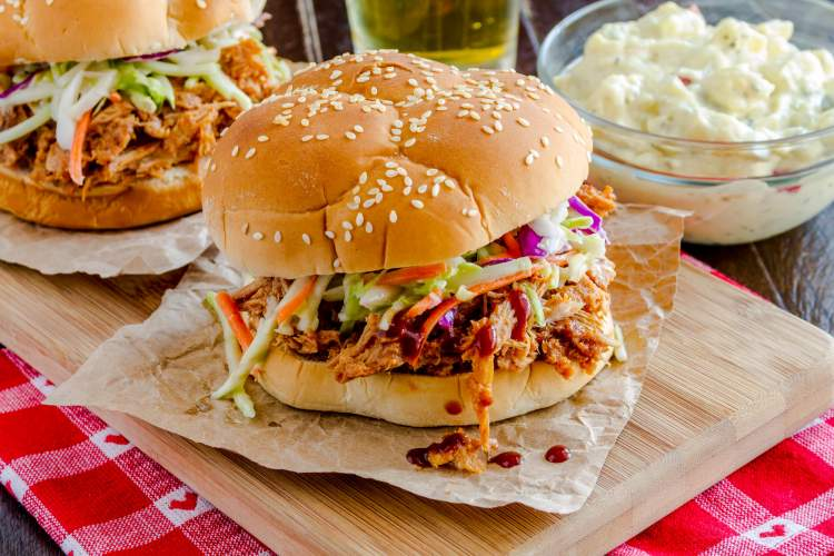 Slow Cooker Barbecue Turkey on sandwich buns with coleslaw.