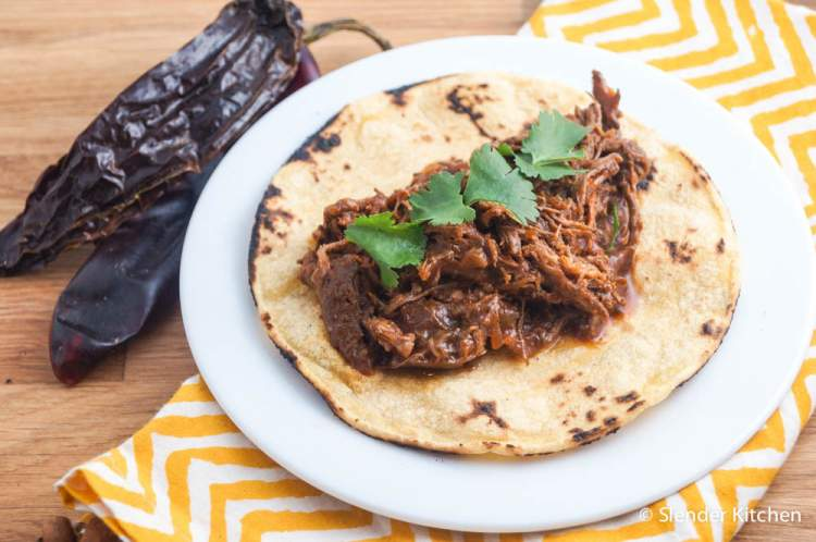 Healthy Taco Recipes with a slow cooker beef in dried chilis for a delicious filling.