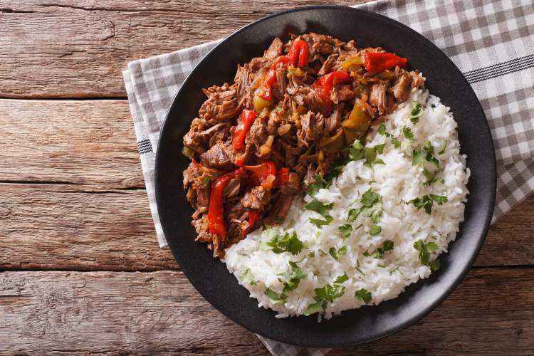 Healthy meal plan with Slow Cooker Beef Machaca on a dish with rice.