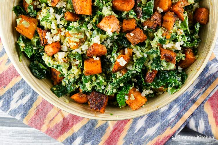 Sweet potato salad with kale and quinoa in a bowl.
