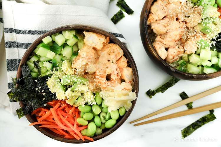 Shrimp Sushi Bowls in a silver pan on a wooden table.