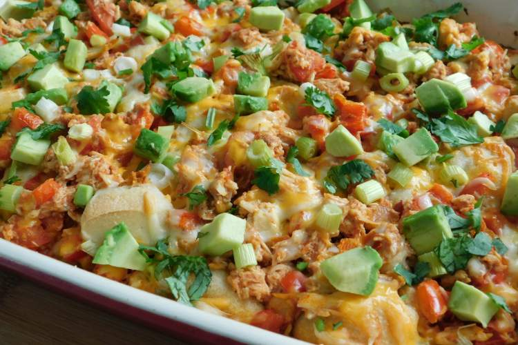 Chicken Enchilada Bubble Up made with refrigerated biscuit dough, chicken breast, enchilada sauce, and veggies is a surprisingly light dish that is packed with flavor.
