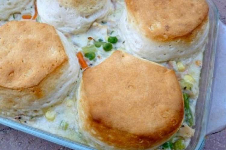 Lightened Up Chicken and Biscuit Pie made with a homemade creamy filling, chicken, and store bought biscuits for a comforting meal in no time.