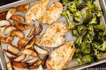 Roasted Chicken and potatoes with broccoli on a sheet pan.
