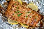 Baked Garlic Lemon Salmon wrapped in foil with honey and cilantro.