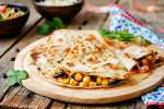 Black Bean and Corn Quesadillas in a flour tortilla with cilantro.