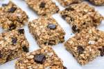 No Bake Oatmeal bars with chocolate chips on parchment paper.